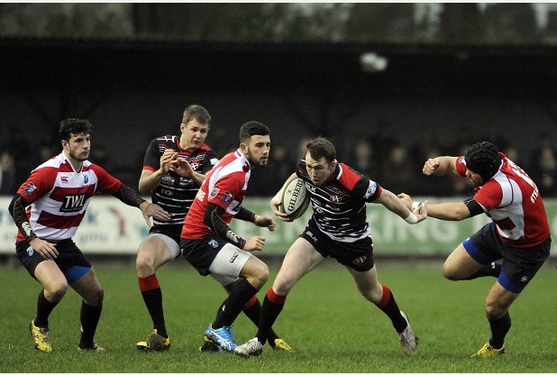 Cornish Pirates, centre Max Bodilly hands off Cardiff Blues Aled Summerhill.